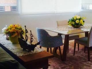 Área social de apartamento de férias : Salas de jantar  por daniela oliveira arquitetura,Tropical