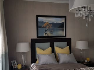 A hint of golden yellow:  Bedroom by Sophistique Interiors