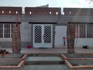 Casa Elia: Casas de estilo  por Concepto Arquitectónico Studio
