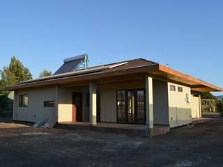 Casas de estilo ecléctico de Qarquitectura Ecléctico