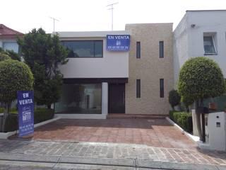 DI+CARQUITECTOS SA DE CV Terrace house Stone Yellow