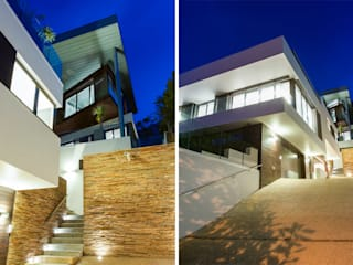 Main house facade from driveway: modern Houses by sisco architects