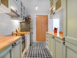 Remodelación Cocina Depto La Macarena: Muebles de cocinas de estilo  por ARCOP Arquitectura & Construcción