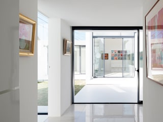 The House for Contemporary Art Minimalist corridor, hallway & stairs by F.A.D.S. Minimalist