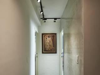 入口廊道:  走廊 & 玄關 by 第宅空間設計