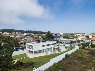 PERSPECTIVA EXTERIOR: Casas unifamilares  por HUGO MONTE | ARQUITECTO