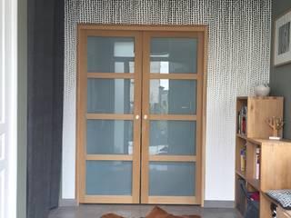 Décoration d'une entrée:  de style  par Conseil Déco & Création