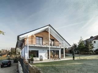 wir leben haus - Bauunternehmen in Bayern Single family home Solid Wood White