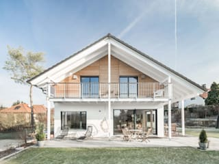 Eclectic style houses by wir leben haus - Bauunternehmen in Bayern Eclectic