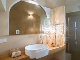Baños de estilo ecléctico de Arch. Antonella Laruccia Ecléctico