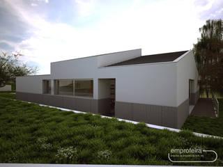 moradia_alçado lateral direito: Moradias  por Emprofeira - empresa de projectos da Feira, Lda.