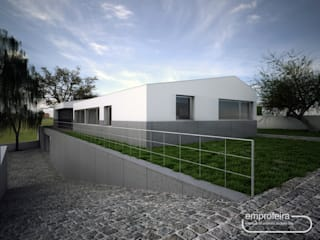 moradia_alçado frontal e lateral esquerdo: Casas unifamilares  por Emprofeira - empresa de projectos da Feira, Lda.