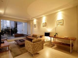 Apartamento E.C., Jardins, São Paulo: Salas de estar  por André Viana Arquitetura,Moderno