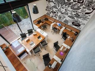 Oficinas Matatena : Oficinas y tiendas de estilo  por Hemisferio Derecho