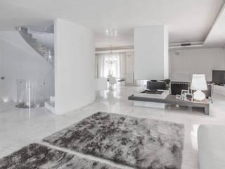 Living: Soggiorno in stile in stile Minimalista di Morelli & Ruggeri Architetti