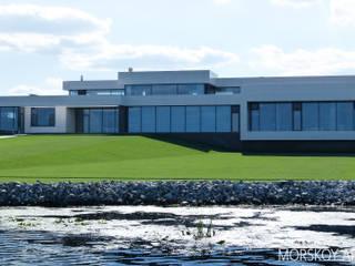 Жилой дом 780 м²: Загородные дома в . Автор – Morskoy Architect