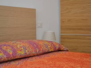 RISTRUTTURAZIONE CASA AL MARE: Camera da letto in stile  di Andrea Magnoni Architetto, Minimalista
