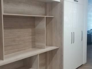 Mueble de acceso con espacio para bicicletas:  de estilo  por VIVE arquitectura