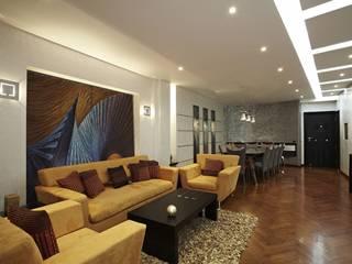 Dokki Apartment:  غرفة المعيشة تنفيذ Hazem Hassan Designs , حداثي