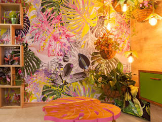 : tropical Living room by Redesign Interiors