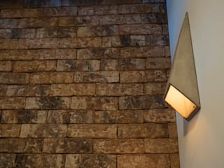 Mobiliario, acabados, closets e interiorismo dpto Ch: Paredes de estilo  por Nube Interiorismo