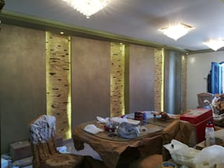 Mr. Taha's Apartment:  غرفة المعيشة تنفيذ Etihad Constructio & Decor