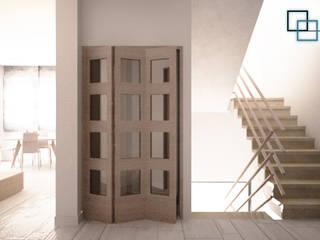 CASA A SCHIERA Ingresso, Corridoio & Scale in stile moderno di DM2L Moderno