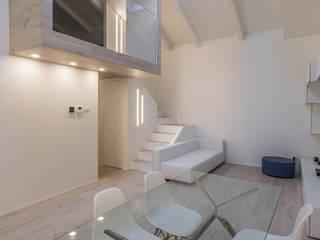Loft M17: Soggiorno in stile  di Biondi Architetti, Minimalista