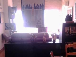 Salón comedor con la pintura y el arte como protagonistas: Salones de estilo  de CONSUELO TORRES