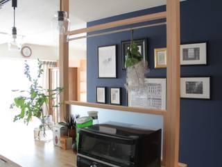 壁のデコレーション: 池田デザイン室(一級建築士事務所)が手掛けたキッチンです。