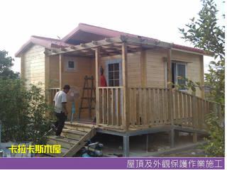 Casas de madera de estilo  por 金城堡股份有限公司