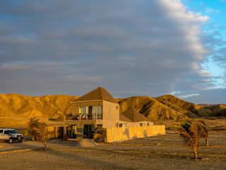 Casas ecológicas de estilo  por Lores STUDIO. arquitectos, Rústico