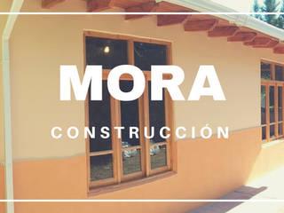 Construcción de ampliación de vivienda con sistema SIPANEL:  de estilo  por Mora Arquitectura y Diseño
