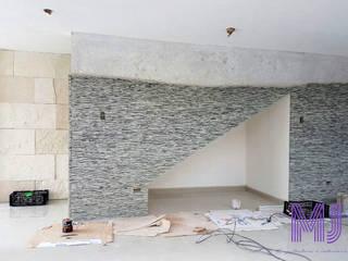Casa L+J: Salas de estilo  por MJ Arquitectura e Interiorismo