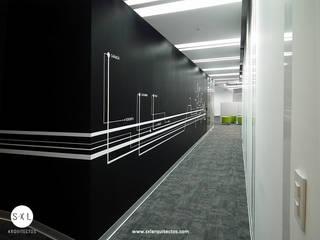 Oficinas Pacific Rubiales Energy: Oficinas de estilo  por SXL ARQUITECTOS,