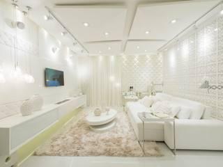 Sala Intima dos 50 tons de branco: Salas de estar  por studio d'design by' laura gransotto,Moderno
