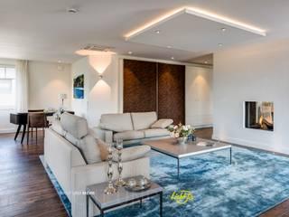 Penthouse - Lichtplanung und Kooperation mit RaumKonzept Lichtja Licht und mehr GmbH Moderne Wohnzimmer