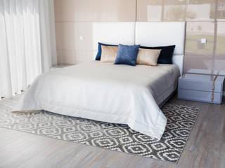 Residência J&M: Quartos  por UNISSIMA Home Couture,Moderno
