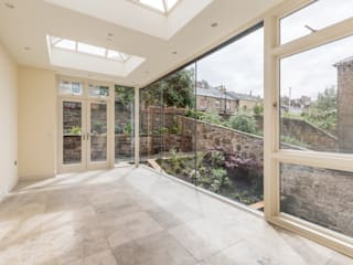 Solid wood conservatory with large windows :  Conservatory by Stange Kraft Ltd