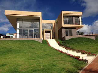 Houses by Arquitectos y Entorno S.A.S,