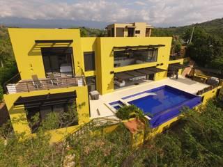 Arquitectos y Entorno S.A.S Casas de estilo minimalista