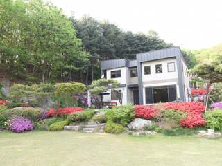 양평 명달리 목조주택 (46py): 한다움건설의  전원 주택