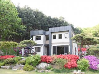 양평 명달리 목조주택 (46py): 한다움건설의  주택