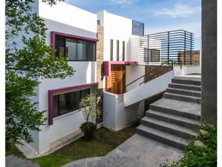 Casas unifamiliares de estilo  por Excelencia en Diseño,