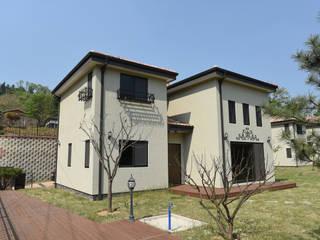 양평 정배리 쌍둥이주택 (42py): 한다움건설의  주택