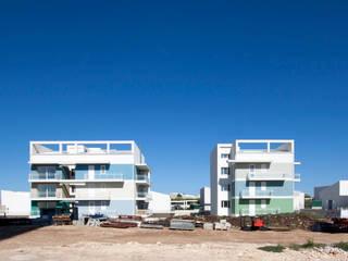 Complesso residenziale MINERVA - 23 alloggi sociali di edilizia convenzionata: Condominio in stile  di studio di architettura Antonio Giummarra