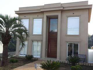 Residência Alphaville Conde: Condomínios  por Squassoni Arquitetura e Construção
