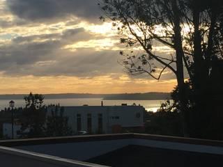 Desde la casa: Chalets de estilo  por Constructora Patagonia Sustentable