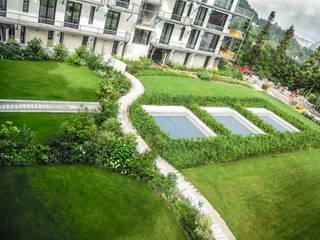 Giardino condominiale a Torino Giardino moderno di Ginkgo Giardini Moderno