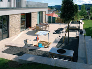 Terrazas de estilo  de seltra Natursteinhandel GmbH